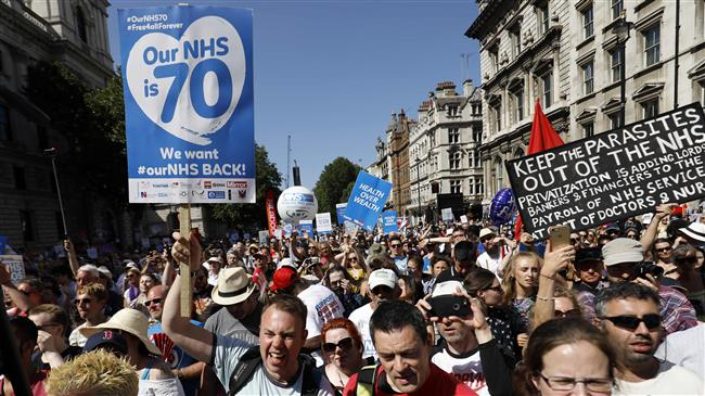 Thousands protest NHS funding: Cuts leave scars