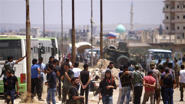 Syria militants begin leaving Dara'a under surrender deal