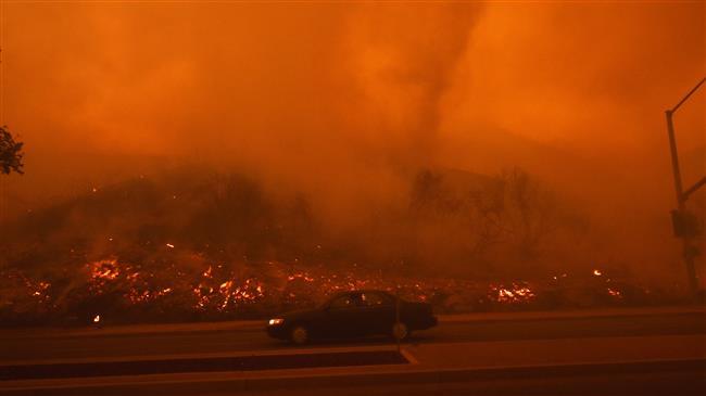 Calif. wildfire said set by arsonist threatens community
