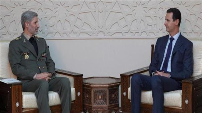 Iran's defense minister hold talks with top Syrian officials