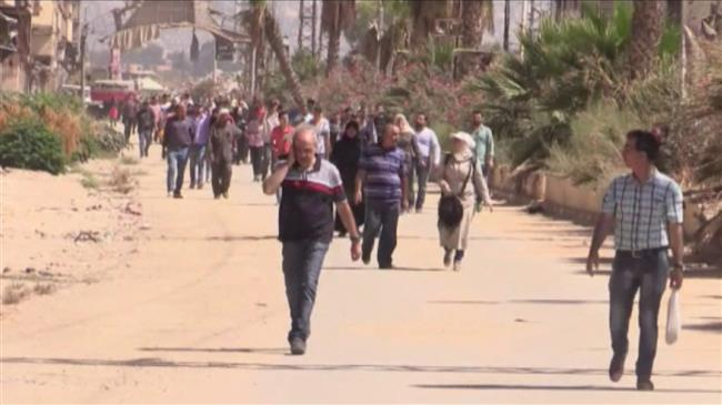 Thousands of displaced Syrians return home