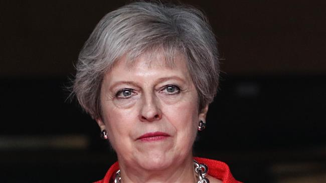 UK PM May downplays impact of no-deal Brexit