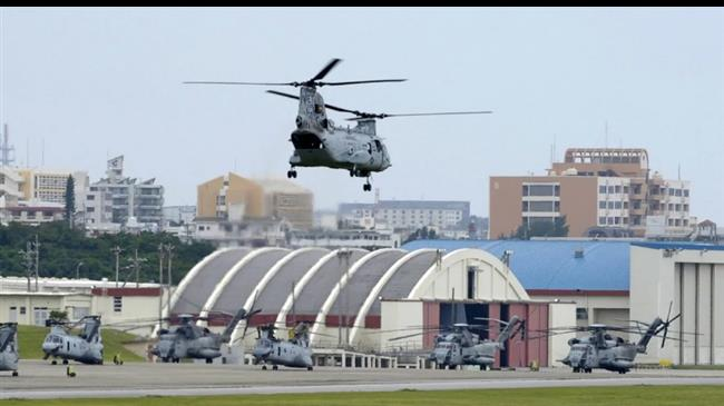 Japan's Okinawa decides to vote on relocating US base