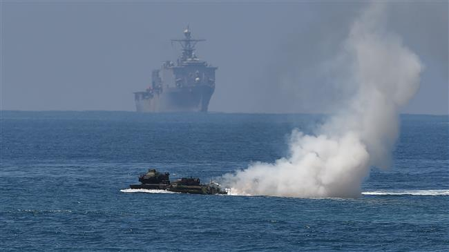 China has 'stern' words with US over warship intrusion