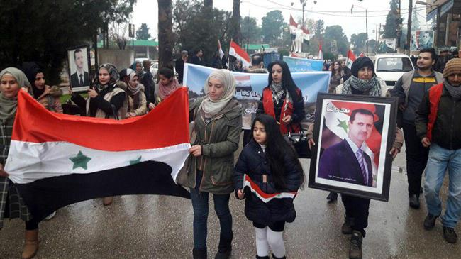 Syrian Kurdish women rally in support of Army