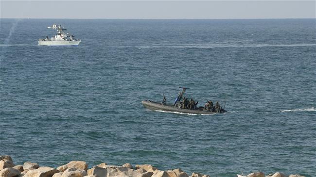 Israeli navy fires at Gaza fishermen, sets boat on fire