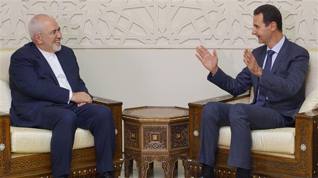 President Assad invites Iran's Zarif to visit Damascus
