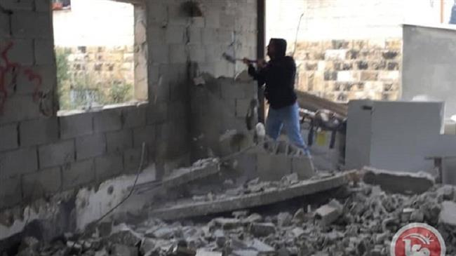Palestinian forced to demolish own house in West Bank