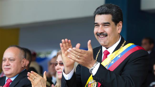 Venezuela forces hold parade as Russia vows support