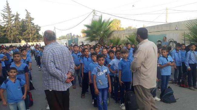 Students in besieged Gaza welcome new school year