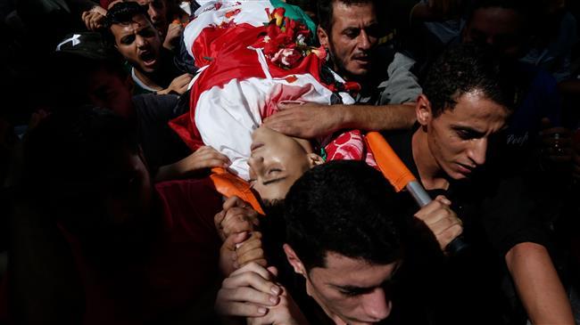 Palestinians bury teen killed by Israeli troops