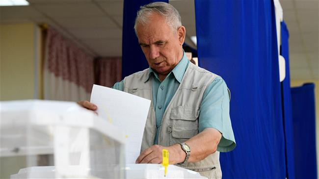 Russians go to polls as Putin squares up to bellicose US