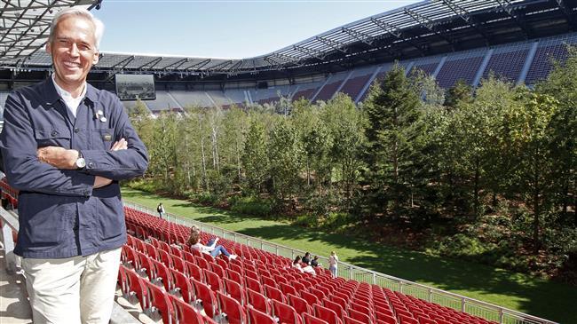 Art installation puts forest into football stadium