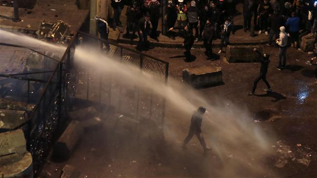 Lebanese police fire water cannons, tear gas at protesters