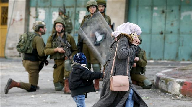 Israeli regime forces injure about 50 Palestinian protesters
