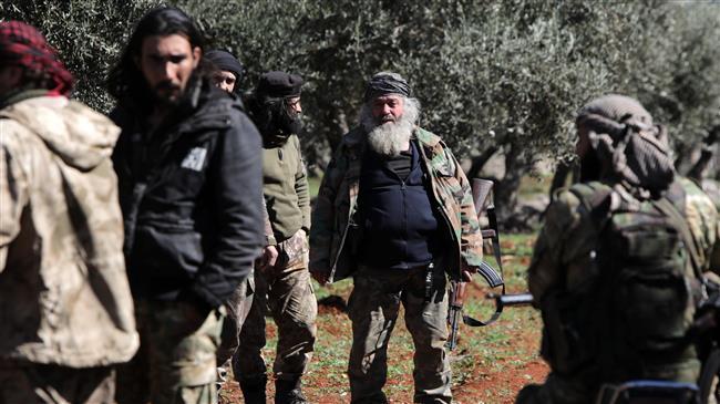 Turkish-backed Takfiri militants burn houses in NE Syria