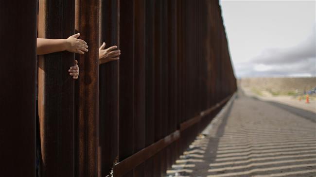 Trump praises border wall before banning immigration
