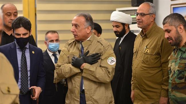 Iraqi premier wears Hashd al-Sha'abi uniform in significant visit to its command center