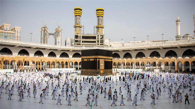 Masked Hajj pilgrims take part in Tawaf after stoning ritual