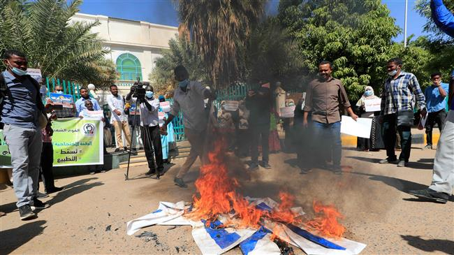 Sudan protesters burn Israeli flag in rally against normalization deal