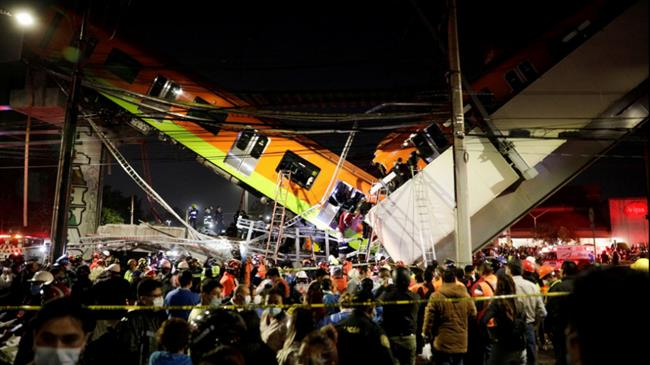 20 dead as Mexico City rail overpass collapses onto road