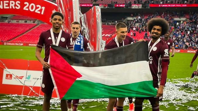 Leicester City's duo hold up Palestine flag after FA Cup victory