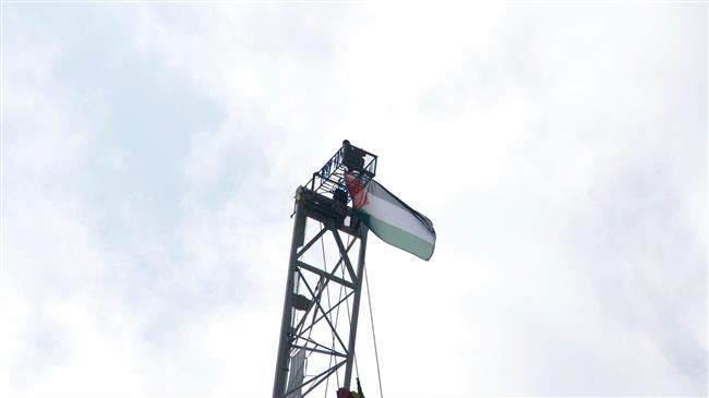 Palestine activist ends death-defying crane protest in London