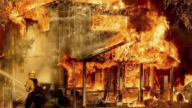 New wildfires burn across US West, as brutal heatwave grips region