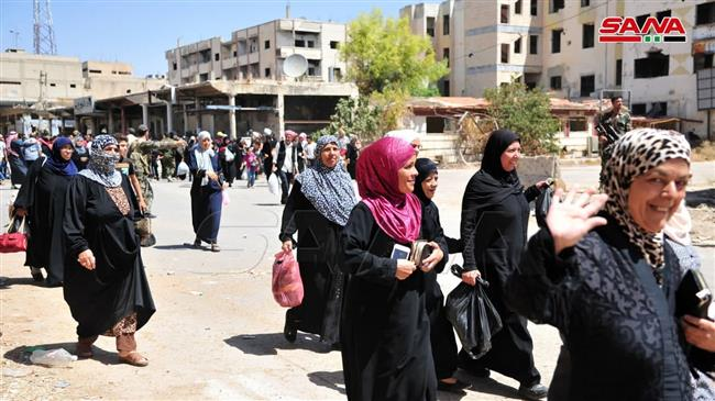 Thousands of Syrians return to their homes after terrorists leave city