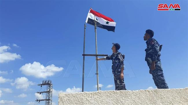 Syrian troops liberate another town in Dara'a, hoist national flag